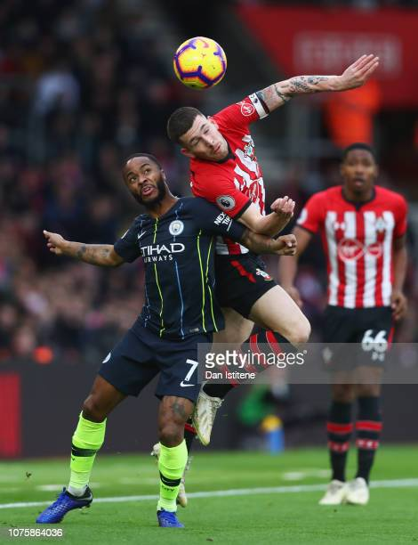 PierreEmile Hojbjerg of Southampton outjumps Raheem Sterling of Manchester City during the Premier League match between Southampton FC and Manchester...