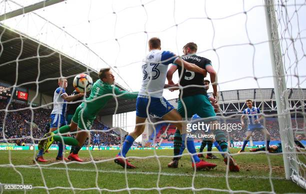 PierreEmile Hojbjerg of Southampton scores their first goal past goalkeeper Christian Walton of Wigan Athletic during The Emirates FA Cup Quarter...