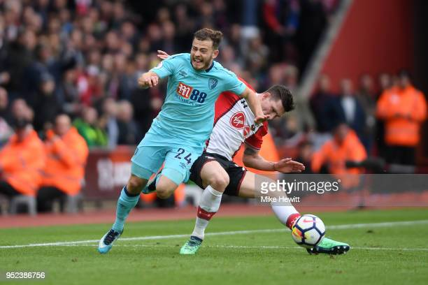 PierreEmile Hojbjerg of Southampton tackles Ryan Fraser of AFC Bournemouth during the Premier League match between Southampton and AFC Bournemouth at...