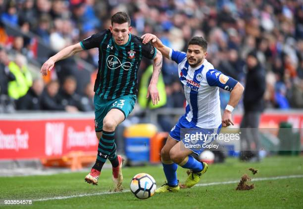 PierreEmile Hojbjerg of Southampton takes on Sam Morsy of Wigan Athletic during The Emirates FA Cup Quarter Final match between Wigan Athletic and...
