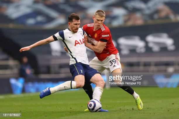 Pierre-Emile Hojbjerg of Tottenham Hotspur battles for possession with Scott McTominay of Manchester United during the Premier League match between...