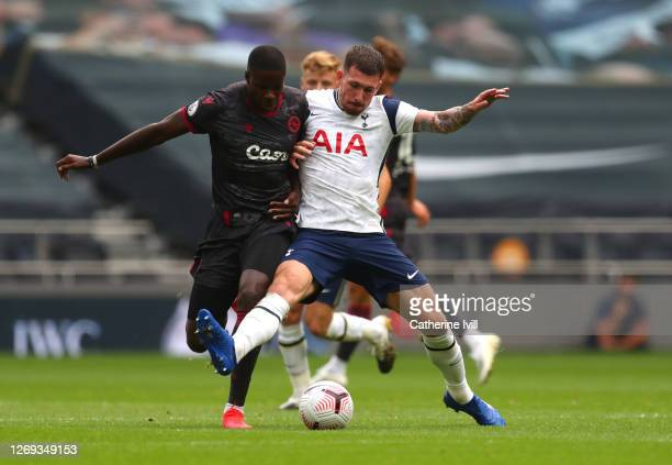 Pierre-Emile Hojbjerg of Tottenham Hotspur battles with Lucas Joao of Reading during the Pre-Season Friendly match between Tottenham Hotspur and...