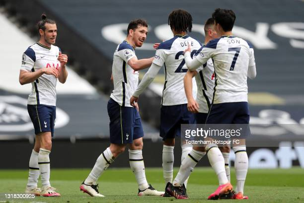 Pierre-Emile Hojbjerg of Tottenham Hotspur celebrates with team mates Gareth Bale, Dele Alli and Son Heung-Min after scoring their side's second goal...
