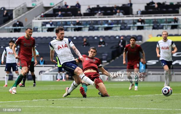 Pierre-Emile Hojbjerg of Tottenham Hotspur scores their side's second goal whilst under pressure from Conor Coady of Wolverhampton Wanderers during...