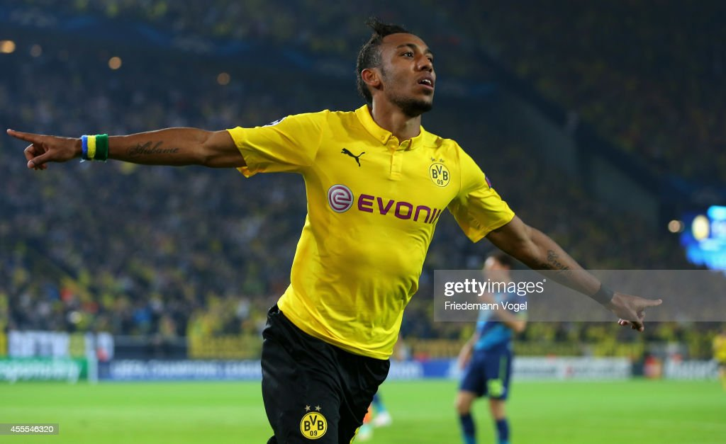 Pierre-Emmerick Aubameyang of Borussia Dortmund celebrates scoring the second goal during the UEFA Champions League Group D match between Borussia Dortmund and Arsenal at Signal Iduna Park on September 16, 2014 in Dortmund, Germany.