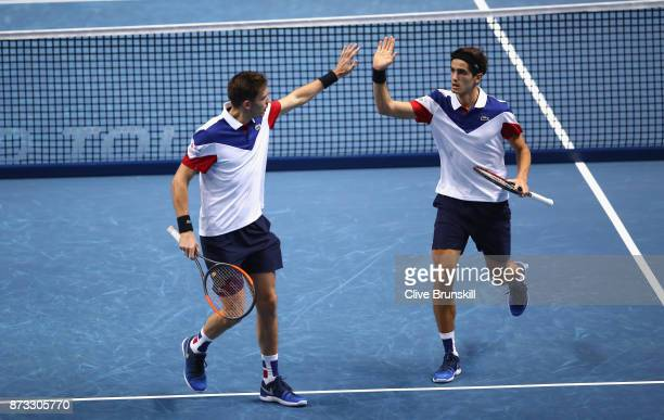 PierreHughes Herbert and Nicolas Mahut of France celebrate a point against JeanJulien Rojer of Netherlands and Horia Tecau of Romania in their first...