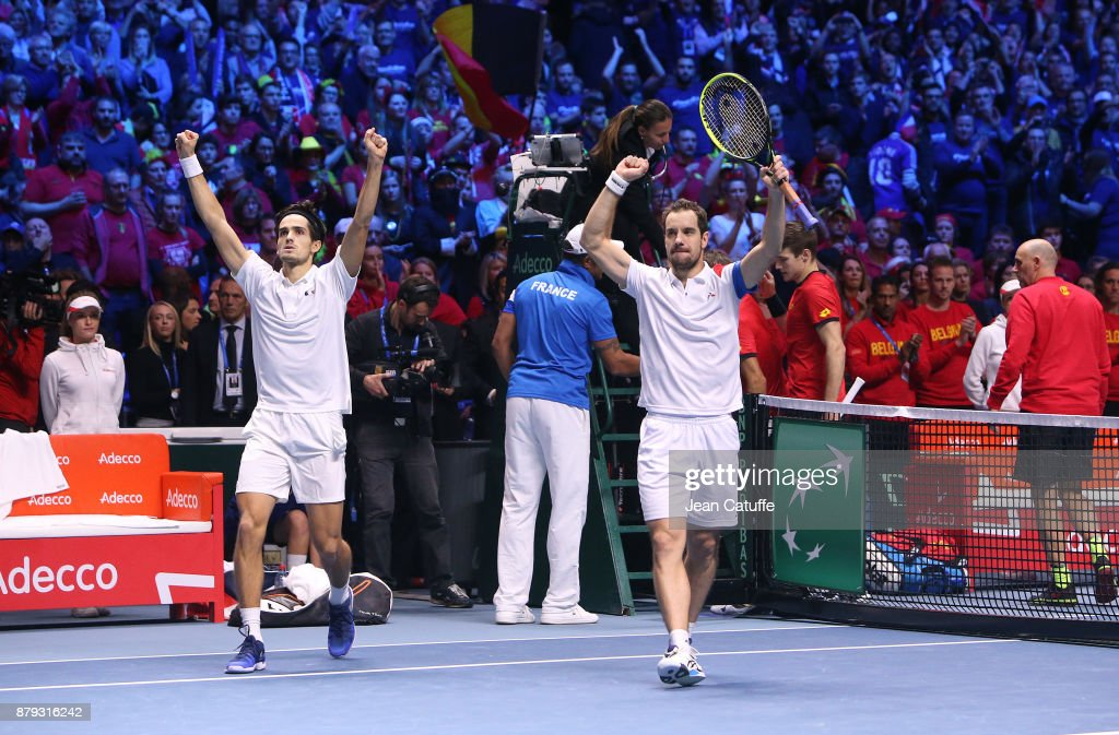 Pierre-Hughes Herbert and Richard Gasquet of France celebrate winning the doubles match during day 2 of the Davis Cup World Group final between France and Belgium at Stade Pierre Mauroy on November 25, 2017 in Lille, France.