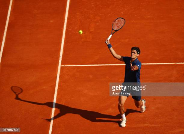 PierreHughes Herbert of France hits a forehand smash during his Mens Singles match against Grigor Dimitrov of Bulgaria at MonteCarlo Sporting Club on...