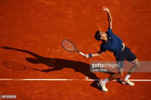 PierreHughes Herbert of France hits serves during his Mens Singles match against Grigor Dimitrov of Bulgaria at MonteCarlo Sporting Club on April 17...