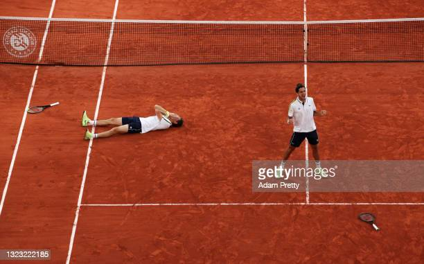 Pierre-Hugues Herbert and Nicolas Mahut of France celebrate after winning the Men's Double's Final on day fourteen of the 2021 French Open at Roland...