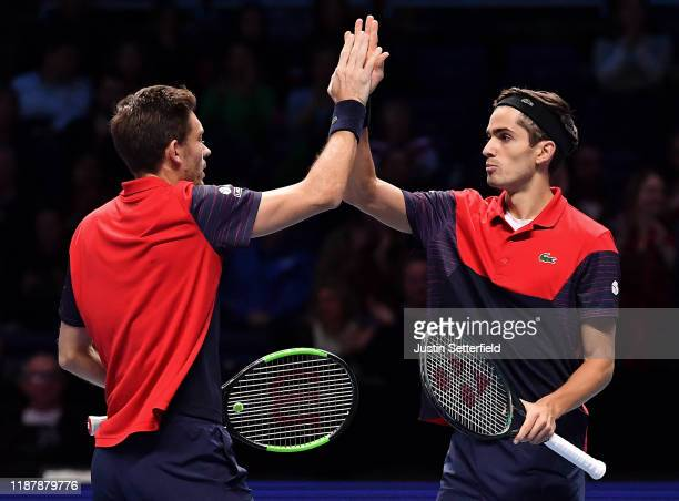 Pierre-Hugues Herbert and Nicolas Mahut of France celebrate match point in their doubles match against Horia Tecau of Romania and Jean-Julien Rojer...