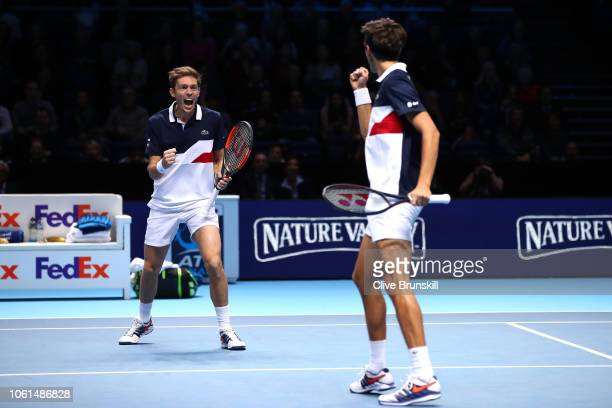 PierreHugues Herbert and Nicolas Mahut of France celebrate match point during their doubles round robin match against Marcelo Melo of Brazil and...