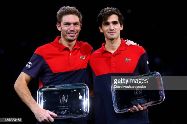 Pierre-Hugues Herbert and Nicolas Mahut of France pose with the winners trophy after victory in their Final match against Karen Khachanov and Andrey...