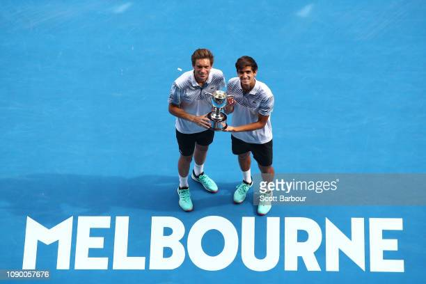 PierreHugues Herbert and Nicolas Mahut of France pose with the championship trophy after their Men's Doubles Final match against John Peers of...