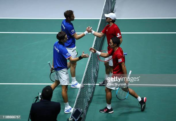 PierreHugues Herbert and Nicolas Mahut of France shake hands with Ben McLachlan and Yasutaka Uchiyama of Japan following their Doubles match during...