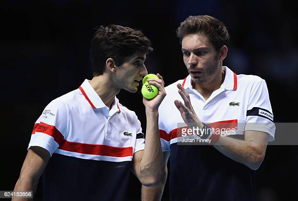 PierreHugues Herbert and Nicolas Mahut of France talk in their men's doubles match against Henri Kontinen of Finland and John Peers of Australia on...