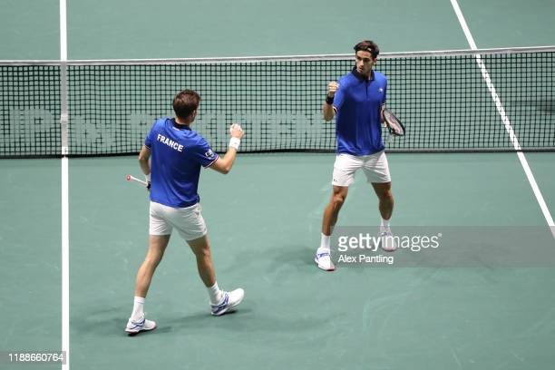 PierreHugues Herbert celebrates with teammate Nicolas Mahut of France during Day 2 of the 2019 Davis Cup at La Caja Magica on November 19 2019 in...