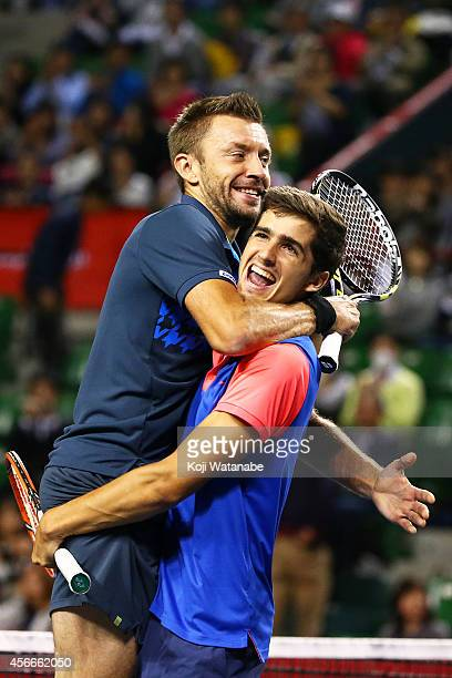 Pierre-Hugues Herbert of France and Michal Przysiezny of Poland celebrate after winning the men's doubles final match against Ivan Dodig of Croatia...