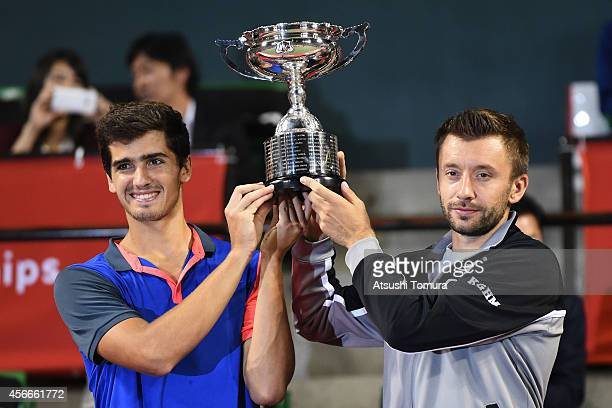 PierreHugues Herbert of France and Michal Przysiezny of Poland celebrate with their trophy after winning the men's doubles final match against Ivan...