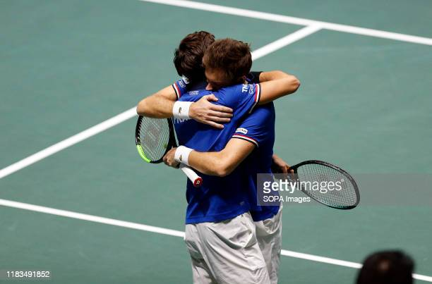 PierreHugues Herbert of France and Nicolas Mahut of France celebrate after their double match against Yasutaka Uchiyama of Japan and Ben McLachlan of...