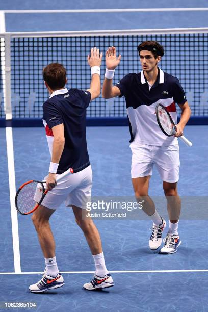 Pierre-Hugues Herbert of France and Nicolas Mahut of France celebrates in their round robin match against Mike Bryan of The United States and Jack...