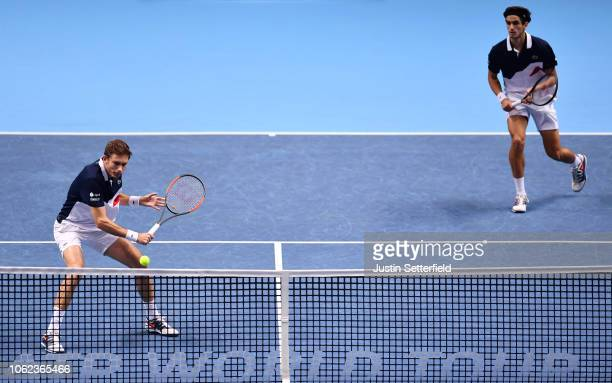 Pierre-Hugues Herbert of France and Nicolas Mahut of France return the ball in their round robin match against Mike Bryan of The United States and...