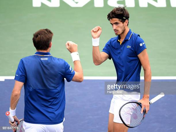 PierreHugues Herbert of France celebrates a point with Nicolas Mahut of France in their match againt Pablo Cuevas of Uruguay and Horacio Zeballos of...