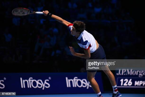 PierreHugues Herbert of France partner of Nicolas Mahut of France returns the ball during the doubles match against Ryan Harrison of The United...