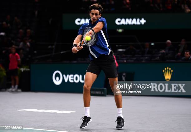 Pierre-Hugues Herbert of France plays a backhand in his first round match against Mikhail Kukushkin of Kazakhstan during Day 2 of the Rolex Paris...