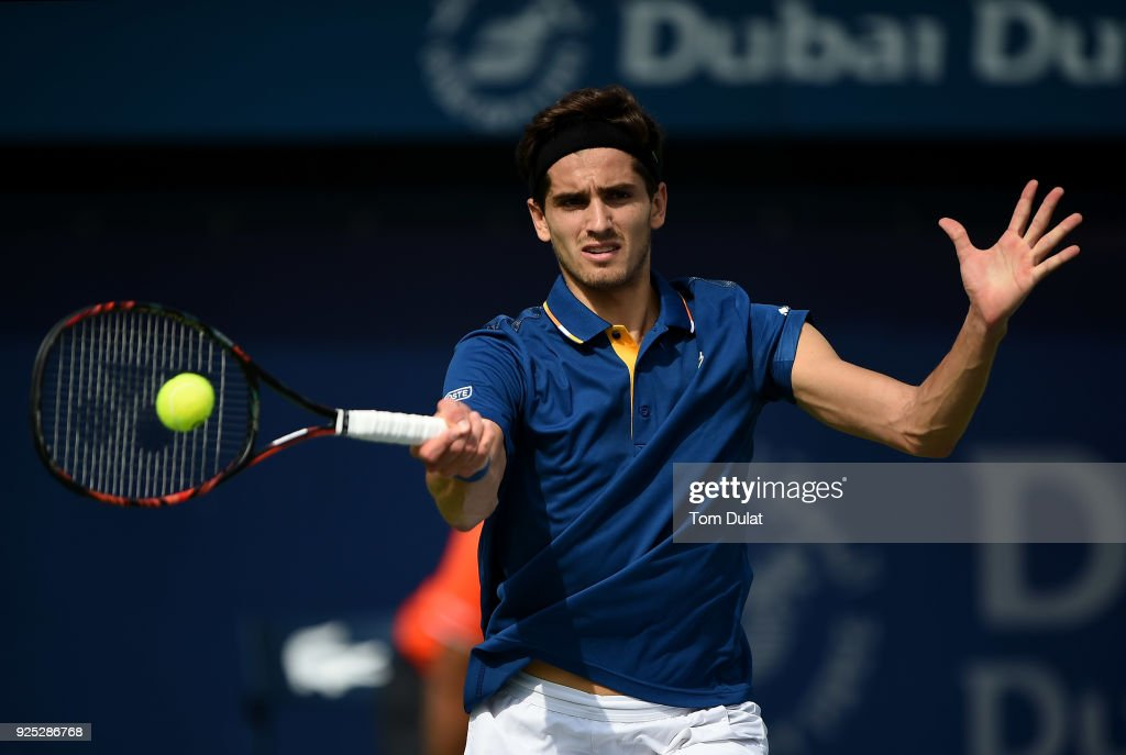 Pierre-Hugues Herbert of France plays a forehand during his match against Roberto Bautista Agut of Spain on day three of the ATP Dubai Duty Free Tennis Championships at the Dubai Duty Free Stadium on February 28, 2018 in Dubai, United Arab Emirates.