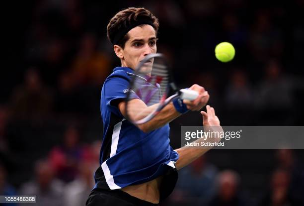 Pierre-Hugues Herbert of France plays a forehand in his first round match against Mikhail Kukushkin of Kazakhstan during Day 2 of the Rolex Paris...