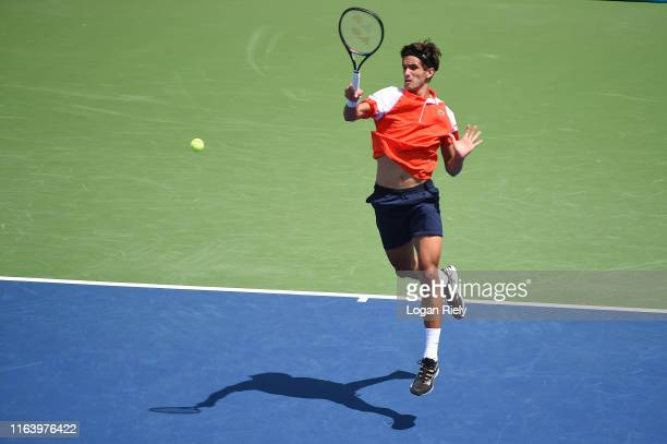 PierreHugues Herbert of France returns a forehand to Alexei Popyrin of Australia during the BBT Atlanta Open at Atlantic Station on July 24 2019 in...