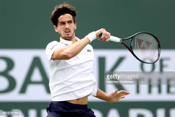 PierreHugues Herbert of France returns a shot to Gael Monfils of France during the BNP Paribas Open at the Indian Wells Tennis Garden on March 13...