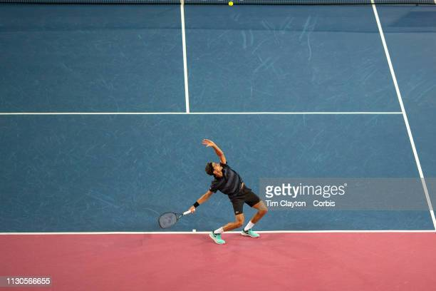 PierreHugues Herbert of France serving against Denis Shapovalov of Canada in the Men's QuarterFinal match during the Open Sud de France Tennis...