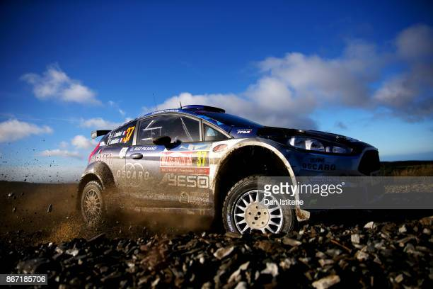 PierreLouis Loubet of France drives with codriver Vincent Landais of France during day one of the FIA World Rally Championship Great Britain on...