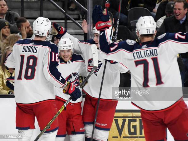 Pierre-Luc Dubois, Cam Atkinson, Zach Werenski and Nick Foligno of the Columbus Blue Jackets celebrate after Werenski assisted Atkinson on his second...