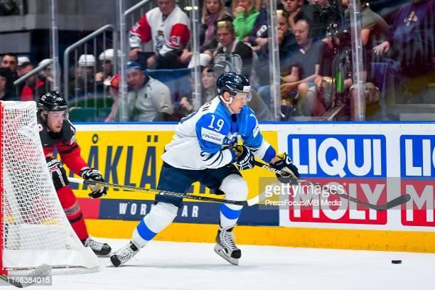 Pierre-Luc Dubois of Canada tackles Veli-Matti Savinainen of Finland during the 2019 IIHF Ice Hockey World Championship Slovakia final game between...