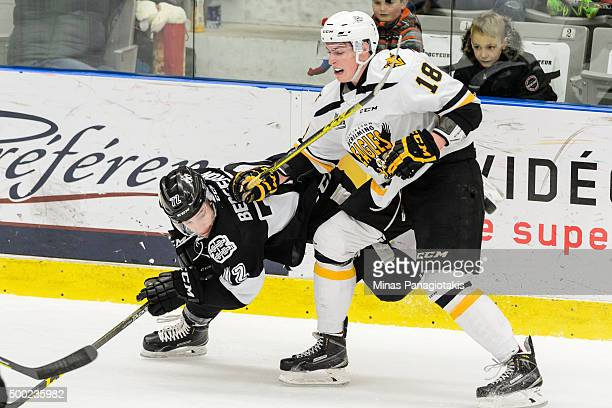 PierreLuc Dubois of the Cape Breton Screaming Eagles takes down Guillaume BergeronCharron of the BlainvilleBoisbriand Armada during the QMJHL game at...