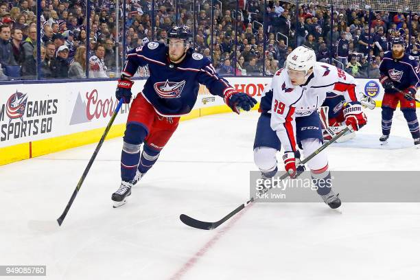 PierreLuc Dubois of the Columbus Blue Jackets and Alex Chiasson of the Washington Capitals chase after the puck in Game Three of the Eastern...