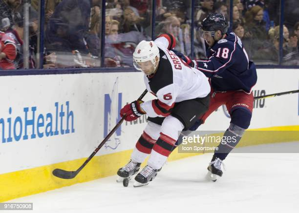 PierreLuc Dubois of the Columbus Blue Jackets and Andy Greene of the New Jersey Devils battle for the puck during the second period of the game...