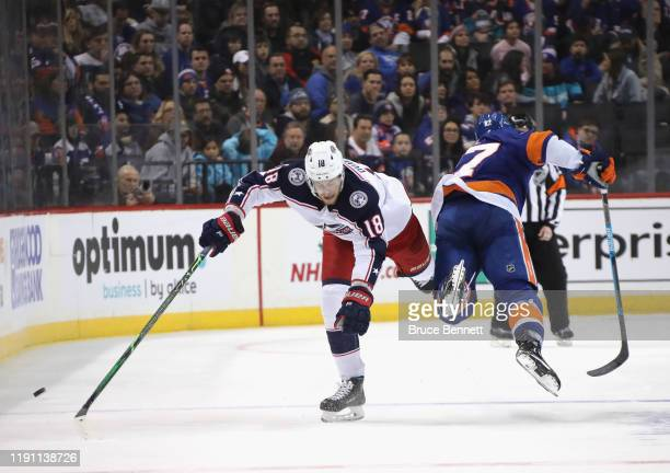 Pierre-Luc Dubois of the Columbus Blue Jackets catches Anders Lee of the New York Islanders with a hip-check during the first period at the Barclays...