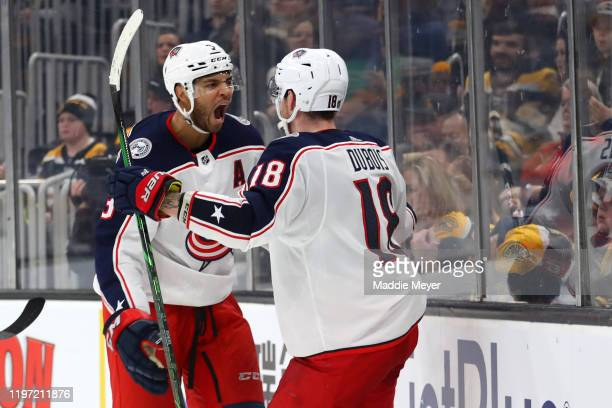 Pierre-Luc Dubois of the Columbus Blue Jackets celebrates with Seth Jones after scoring a goal to defeat the Boston Bruins 2-1 in overtime at TD...
