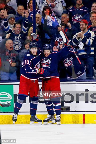 PierreLuc Dubois of the Columbus Blue Jackets congratulates Artemi Panarin of the Columbus Blue Jackets after scoring a goal during the third period...