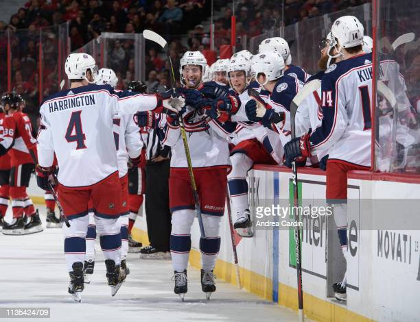 Pierre-Luc Dubois of the Columbus Blue Jackets high fives the bench after scoring a first period goal against the Ottawa Senators at Canadian Tire...