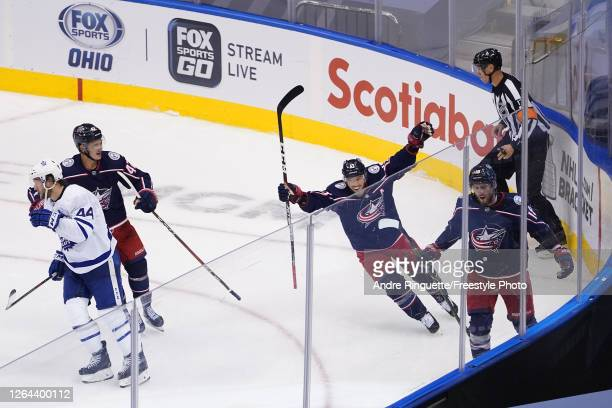 Pierre-Luc Dubois of the Columbus Blue Jackets is congratulated by his teammates Cam Atkinson and Alexandre Texier after scoring the game-winning...
