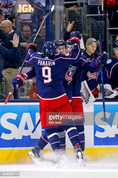 PierreLuc Dubois of the Columbus Blue Jackets is congratulated by Artemi Panarin of the Columbus Blue Jackets and Zach Werenski of the Columbus Blue...