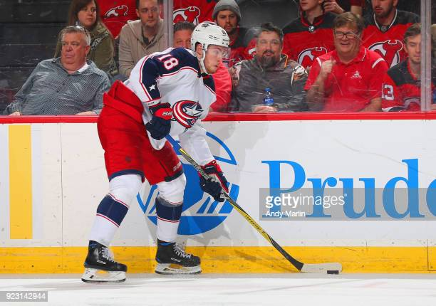 PierreLuc Dubois of the Columbus Blue Jackets plays the puck during the game against the New Jersey Devils at Prudential Center on February 20 2018...