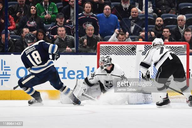 Pierre-Luc Dubois of the Columbus Blue Jackets scores on goaltender Jack Campbell of the Los Angeles Kings during the overtime period of a game on...