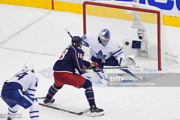 PierreLuc Dubois of the Columbus Blue Jackets scores the gamewinning goal past Frederik Andersen of the Toronto Maple Leafs during the first overtime...