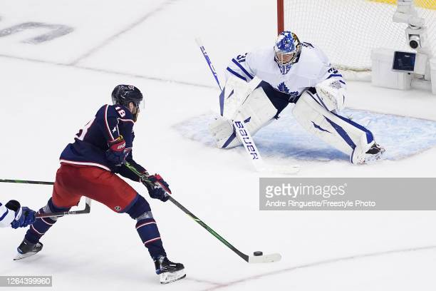 Pierre-Luc Dubois of the Columbus Blue Jackets scores the game-winning goal past Frederik Andersen of the Toronto Maple Leafs during the first...
